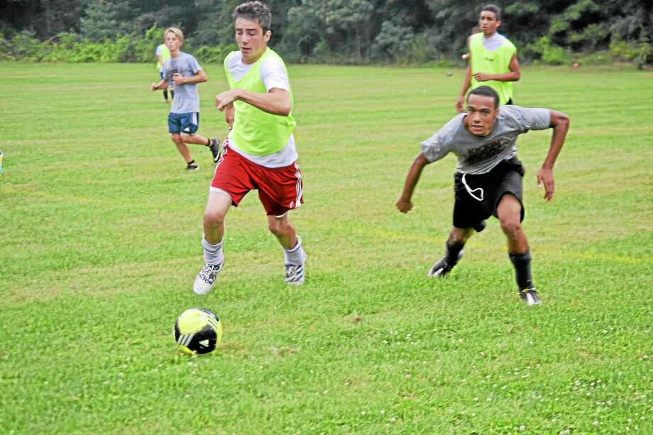 Shane Bierfeldt (left) makes a move past a teammates during an intrasquad match last week. Bierfeldt will be a big part of the Red Raiders success this season. Photo: Pete Paguaga—Register Citizen