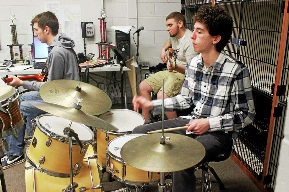 Students at Litchfield High School jazz band are rehearing. Photo: Shako Liu — The Register Citizen