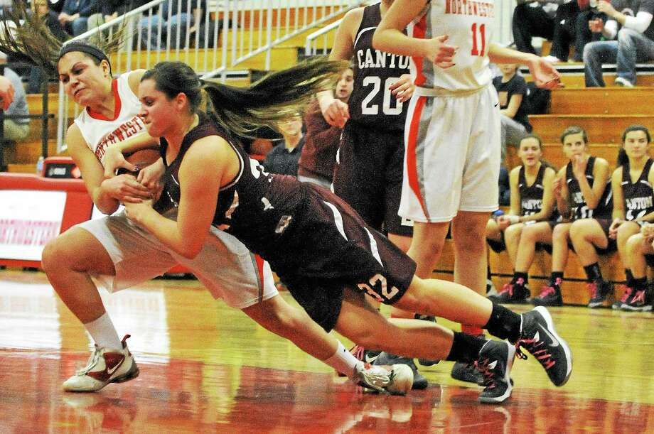 Northwestern's Liz Newkirk and Canton's Gabby Rose fight for the ball in the Highlanders 40-31 loss to the Warriors. Photo: Laurie Gaboardi — Register Citizen