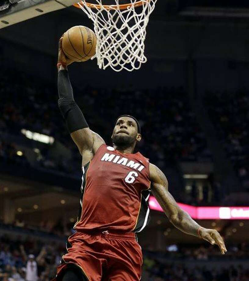 Miami Heat's LeBron James dunks against the Milwaukee Bucks during the first half of Game 4 in a first-round NBA basketball playoff series, Sunday, April. 28, 2013, in Milwaukee. (AP Photo/Jeffrey Phelps) Photo: ASSOCIATED PRESS / AP2013