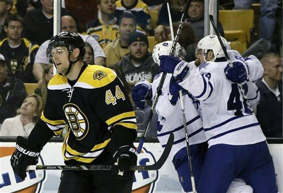 Boston Bruins defenseman Dennis Seidenberg (44) reacts as Toronto Maple Leafs right wing Phil Kessel (81) celebrates his goal with left wing Ryan Hamilton (48) and center Nazem Kadri (43) during the third period in Game 2 of a first-round NHL hockey playoff series in Boston, Saturday, May 4, 2013. (AP Photo/Elise Amendola) Photo: AP / AP