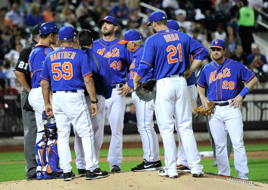Mets pitcher Jonathon Niese (49) talks with manager Terry Collins (10) before he was taken out of the game during the sixth inning of New York's 3-1 loss to the visiting Houston Astros on Friday at Citi Field. Photo: Bill Kostroun — The Associated Press  / FR51951 AP