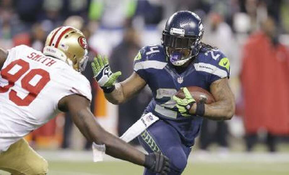Seattle Seahawks' Marshawn Lynch rushes in the NFL football NFC Championship game Sunday, Jan. 19, 2014, in Seattle. The Seahawks beat the San Francisco 49ers 23-17 to advance to the Super Bowl.