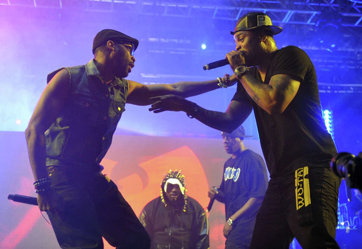Robert Fitzgerald Diggs, aka Rza, left, and Clifford Smith, aka Method Man, of Wu-Tang Clan perform at the second weekend of the 2013 Coachella Valley Music and Arts Festival at the Empire Polo Club on Sunday, April 21, 2013 in Indio, Calif. . (Photo by John Shearer/Invision/AP)