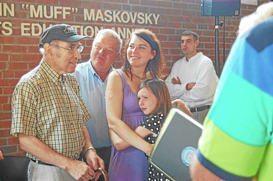 """Marvin """"Muff"""" Maskovsky, left, stands with his family during the dedication of the Warner Theatre's Arts Annex in his name on Friday, Aug. 30. Photo: Jenny Golfin—Register Citizen"""