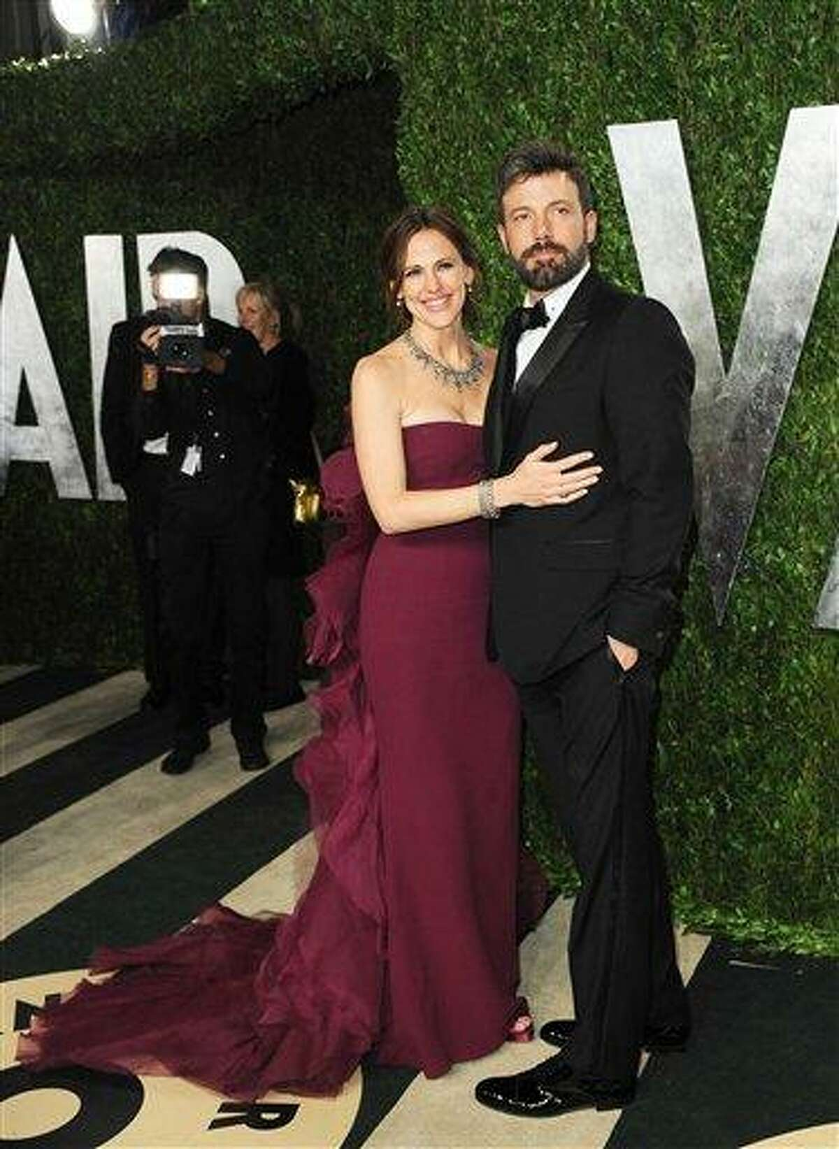 Actress Jennifer Garner, left, and director Ben Affleck arrive at the 2013 Vanity Fair Oscar party on Sunday, Feb. 24 2013 at the Sunset Plaza Hotel in West Hollywood, Calif. (Photo by Jordan Strauss/Invision/AP)