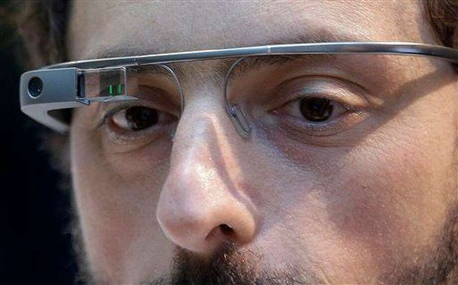 "Google co-rounder Sergey Brin wears Google Glass glasses at an announcement for the Breakthrough Prize in Life Sciences at Genentech Hall on UCSF's Mission Bay campus in San Francisco, Wednesday, Feb. 20, 2013. Google is giving more people a chance to pay $1,500 for a pair of the Internet-connected glasses that the company is touting as the next breakthrough in mobile computing. The product, dubbed ""Google Glass,"" will be offered to ""bold, creative individuals"" selected as part of a contest announced Wednesday. Participants must live in the U.S. and submit an application of up to 50 words explaining what they would do with the Google Glass technology. (AP Photo/Jeff Chiu) Photo: AP / AP"