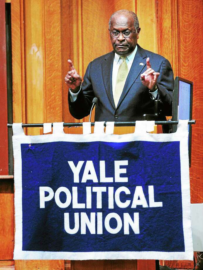 (Arnold Gold — New Haven Register)  Herman Cain answers questions during his appearance as a guest of the Yale Political Union at Yale University in New Haven on 9/3/2013. Photo: Journal Register Co.