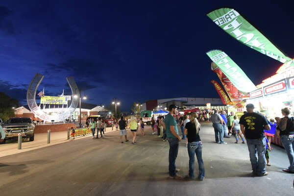 Midland County Fair visitors stroll along the grounds of the Horseshoe on Friday night. The annual event, which was Aug. 24 through Aug. 27, featured carnival rides, food booths, petting zoo, a rodeo and musical entertainment.