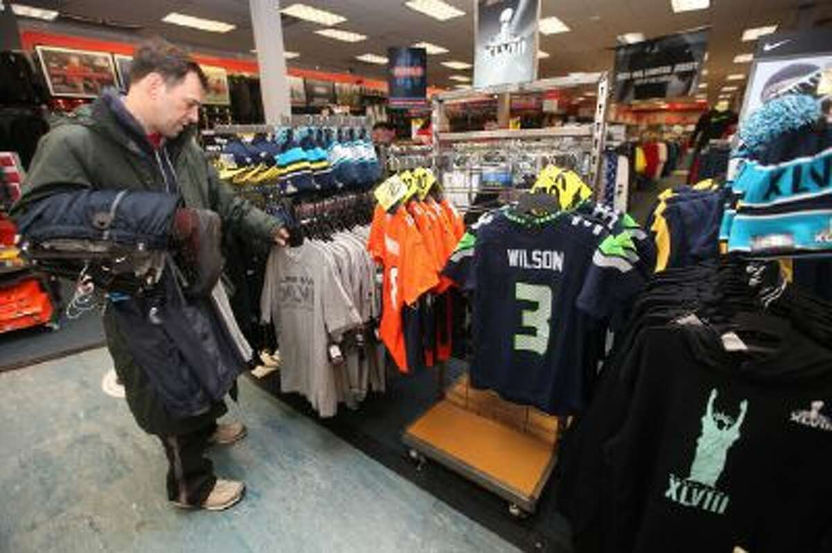 Michael Berman of Fair Lawn looks to buy a birthday present for his nephew from the selection of items being merchandised for Super Bowl XLVIII on display at Modell's.
