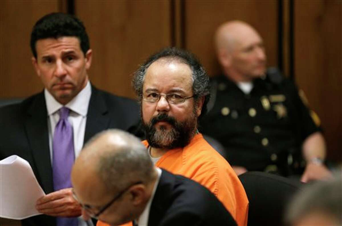 FILE - In this July 26, 2013 Ariel Castro sits in a Cleveland courtroom where he pleaded guilty to 937 counts of rape and kidnapping for holding three women captive in his home for a decade. Castro, 53, serving a life sentence for the kidnapping and rape, was found hanging in his cell, Tuesday night, Sept. 3, 2013, at the Correctional Reception Center in Orient, Ohio. (AP Photo/Tony Dejak, File)