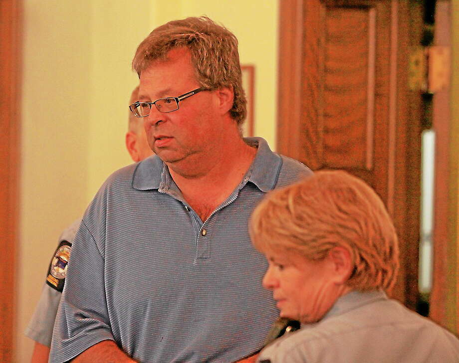 Former Winsted finance director Henry Centrella is arraigned in Litchfield Superior Court on first-degree larceny charges on Aug. 30, 2013. Photo: John McKenna—Pool Photo—Republican American