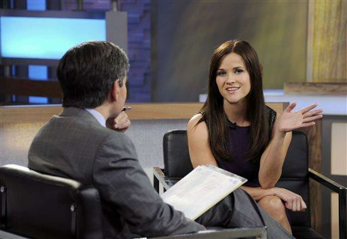 This image released by ABC news shows co-host George Stephanopoulos, left, interviewing actress Reese Witherspoon on