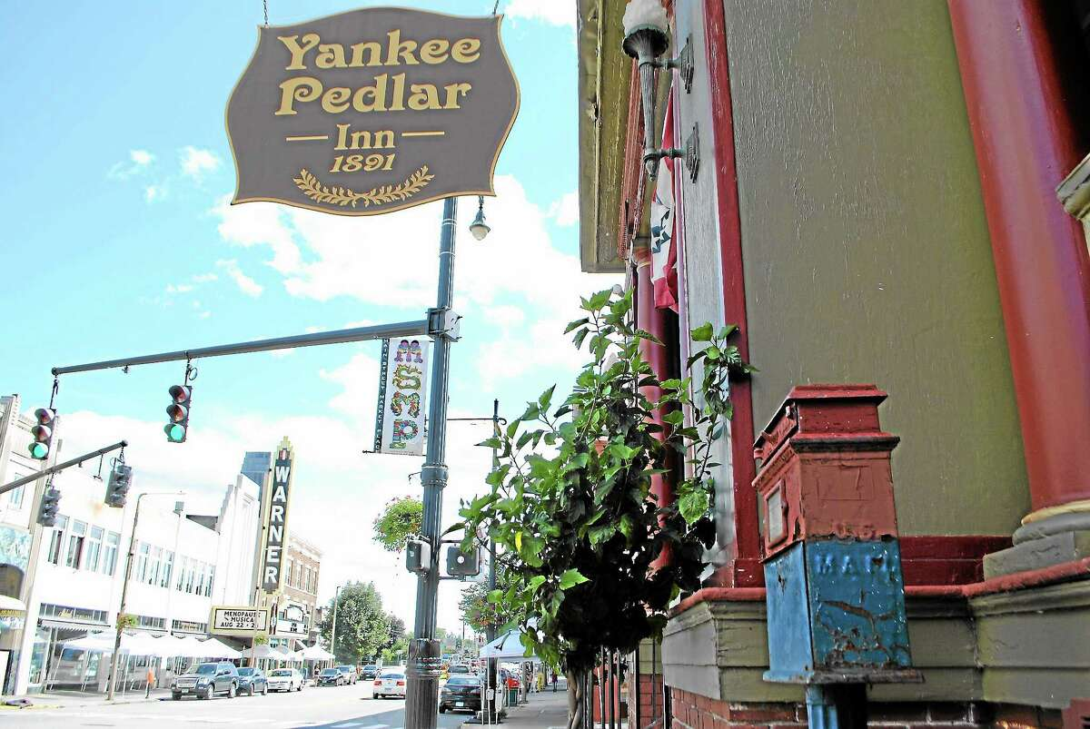 A 100-year-old Van Dorn mailbox, seen at the bottom right, was removed from the sidewalk in front of the Yankee Pedlar Inn in Torrington on Tuesday.