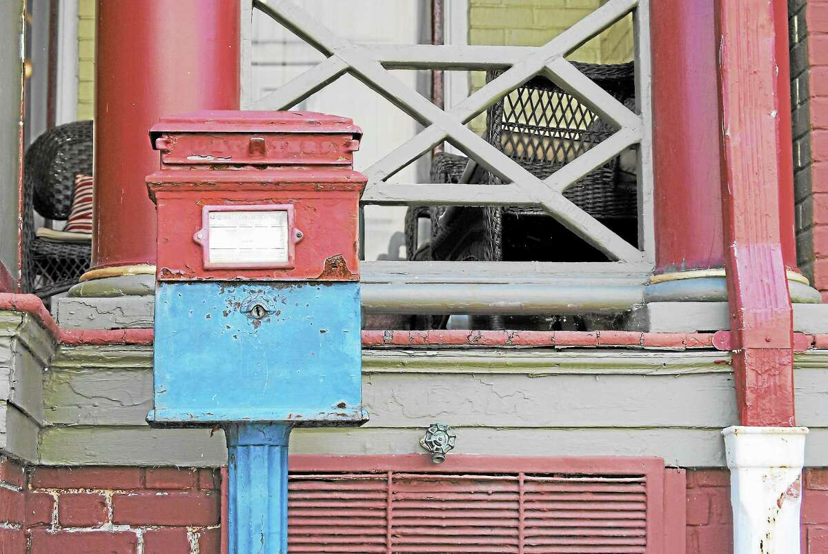 A 100-year-old Van Dorn lamppost mailbox was removed from the sidewalk in front of the Yankee Pedlar, Tuesday.
