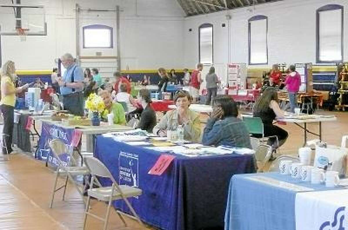 Kate Hartman/Register Citizen -- Local agencies set up booths in the Torrington Armory to provide information to the homeless during the Project Homeless Connect event.