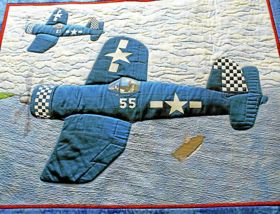"Submitted photo - New England Air MuseumAbove, a quilt from the 2012 quilt show at the New England Air Museum. The New England Air Museum is hosting its ""Flights & Fantasies"" Quilt Show from Sept. 16-22. Photo: Journal Register Co."