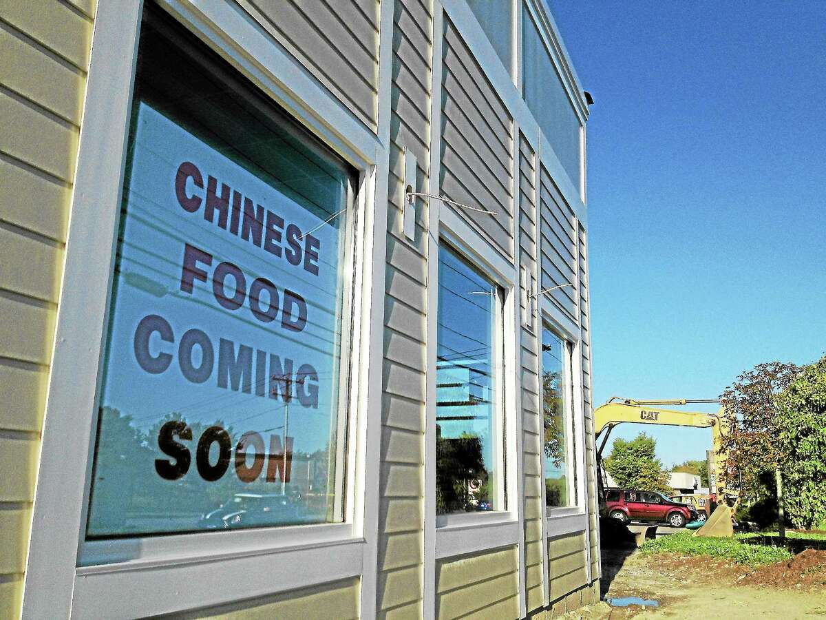 """A sign outside a building on 1891 E. Main St. in Torrington on Wednesday, Sept. 4, reads """"Chinese Restaurant coming soon"""" despite it not being planned to house a restaurant, according to city documents. The city has asked the plaza owner to take the sign down."""