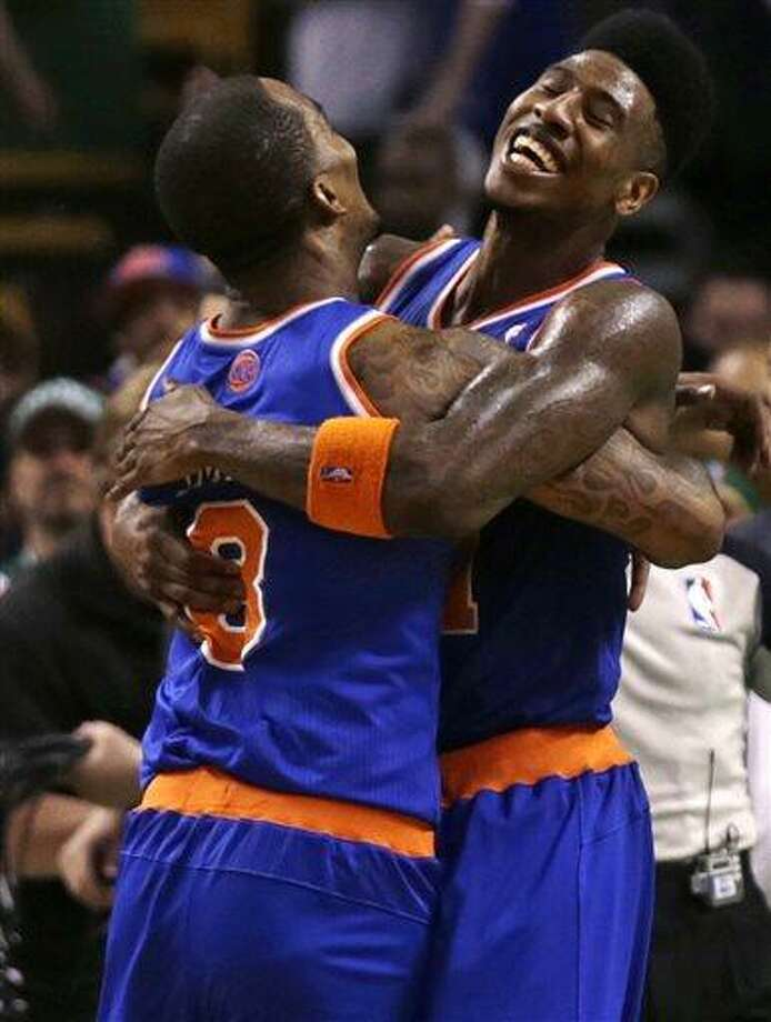 New York Knicks small forward Iman Shumpert, right is embraced by teammate J.R. Smith after defeating the Boston Celtics in Game 6 of their first-round NBA basketball playoff series in Boston, Friday, May 3, 2013. The Knicks won 88-80, eliminating the Celtics from the playoffs. (AP Photo/Charles Krupa) Photo: AP / AP