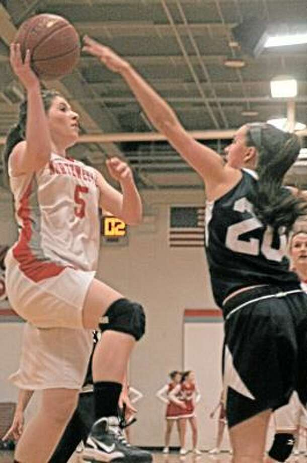 Northwestern's Kathleen Wysocki goes up for a layup as Immaculate's Mackenzie Mitchell attempts to block. Sean Meenaghan/Register Citizen.