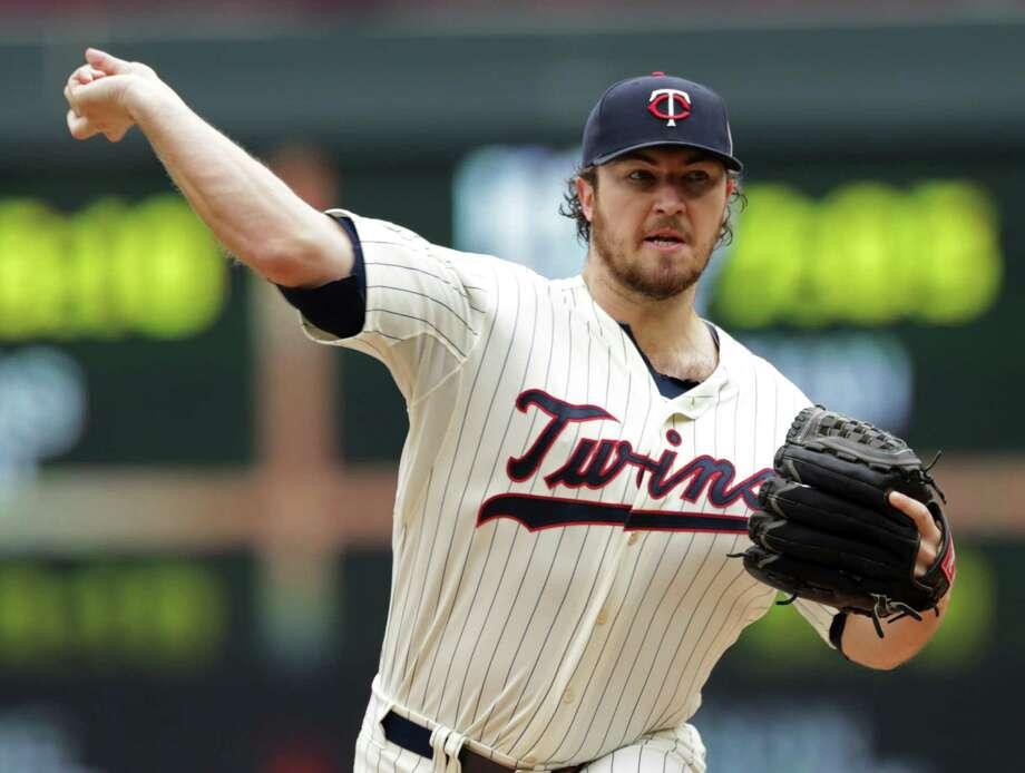 Minnesota Twins pitcher Phil Hughes throws against the Arizona Diamondbacks Wednesday in Minneapolis. Photo: Jim Mone — The Associated Press  / AP