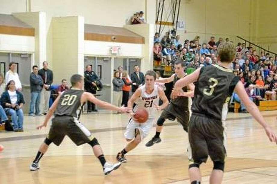 Terryville's Jacob Johnson weaves through defenders Thomaston defenders. Pete Paguaga/Register Citizen