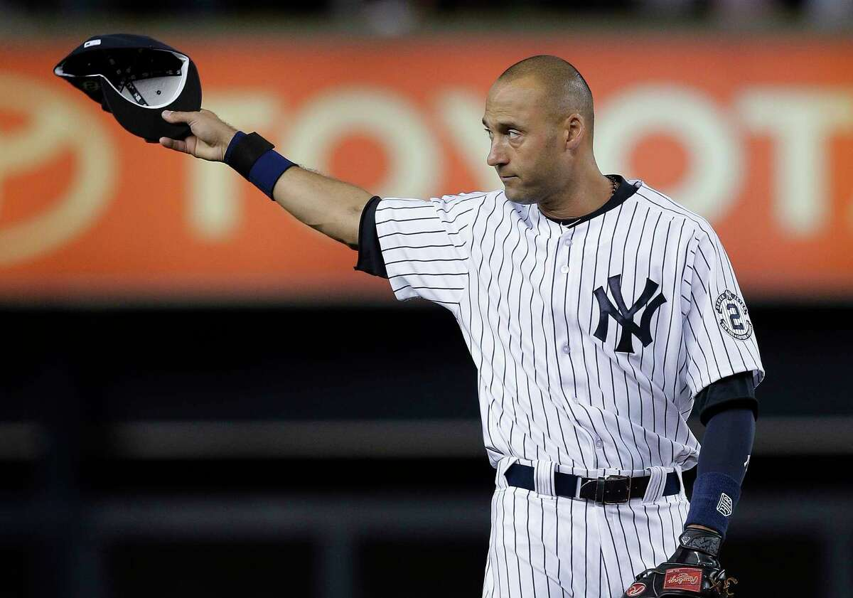 Yankees shortstop Derek Jeter acknowledges applause from fans as he takes the field on Thursday.