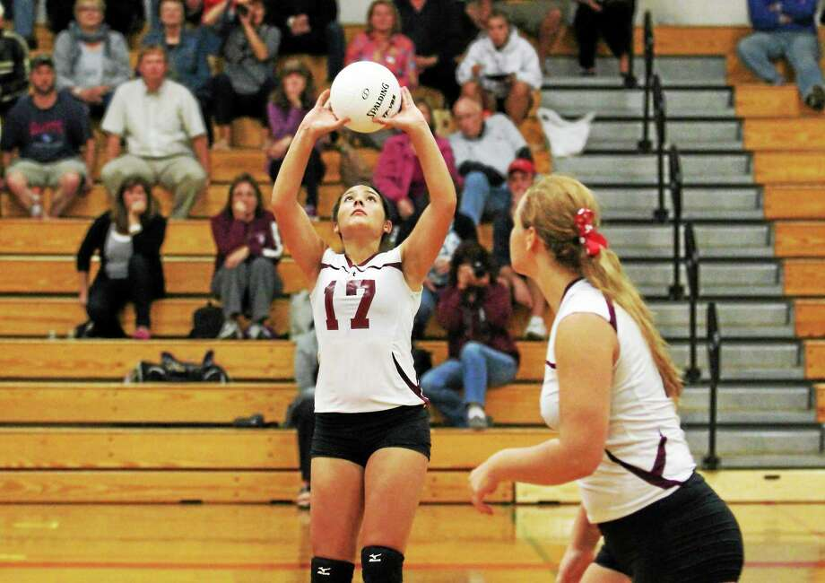 Torrington's Jayleen Colon sets up a teammate in the Red Raiders' 3-0 win over Ansonia. Photo: Marianne Killackey — Special To The Register Citizen  / 2014