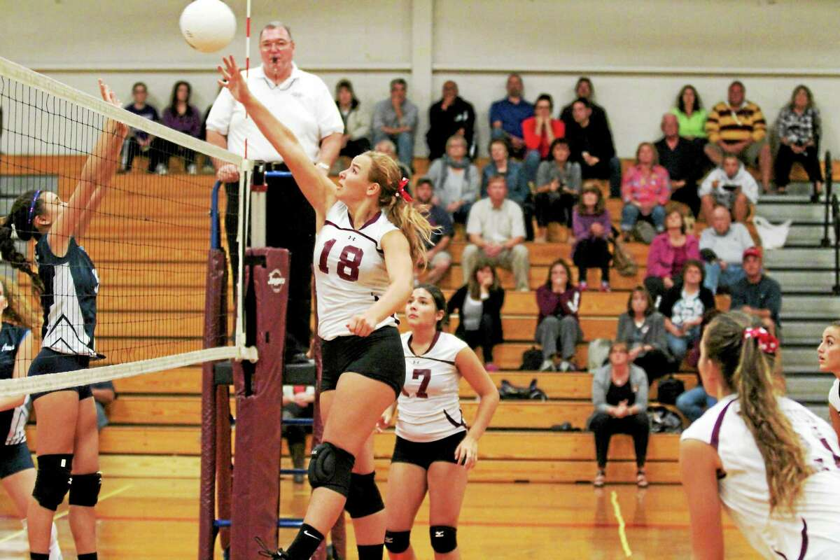 Torrington's Caitlyn Cornish spikes the ball in the Red Raiders' 3-0 win over Ansonia.