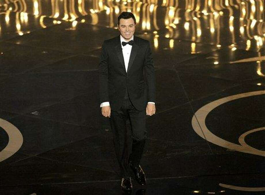 Host Seth MacFarlane speaks onstage during the Oscars at the Dolby Theatre on Sunday Feb. 24, 2013, in Los Angeles.  (Photo by Chris Pizzello/Invision/AP) Photo: Chris Pizzello/Invision/AP / Invision