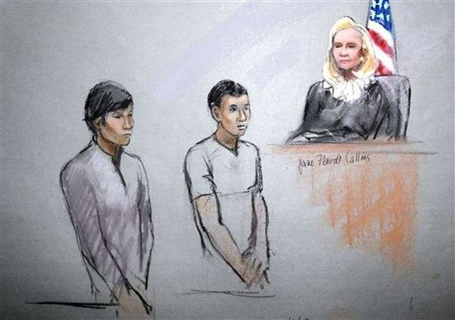 This courtroom sketch signed by artist Jane Flavell Collins shows defendants Dias Kadyrbayev, left, and Azamat Tazhayakov appearing in front of Federal Magistrate Marianne Bowler at the Moakley Federal Courthouse in Boston on Wednesday, May 1, 2013.  The two college friends of Boston Marathon bombing suspect Dzhokhar Tsarnaev, and another man, were arrested and charged with removing a backpack containing hollowed-out fireworks from Tsarnaev's dorm room. (AP Photo/Jane Flavell Collins) Photo: ASSOCIATED PRESS / AP2013
