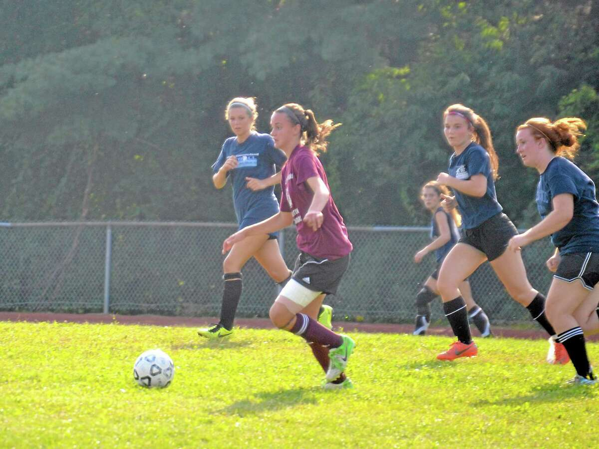 Olivia Morrison runs past Housatonic defenders during a scrimmage last week. The Raiders season opens up at Ansonia at 4 p.m. on Sept 10.