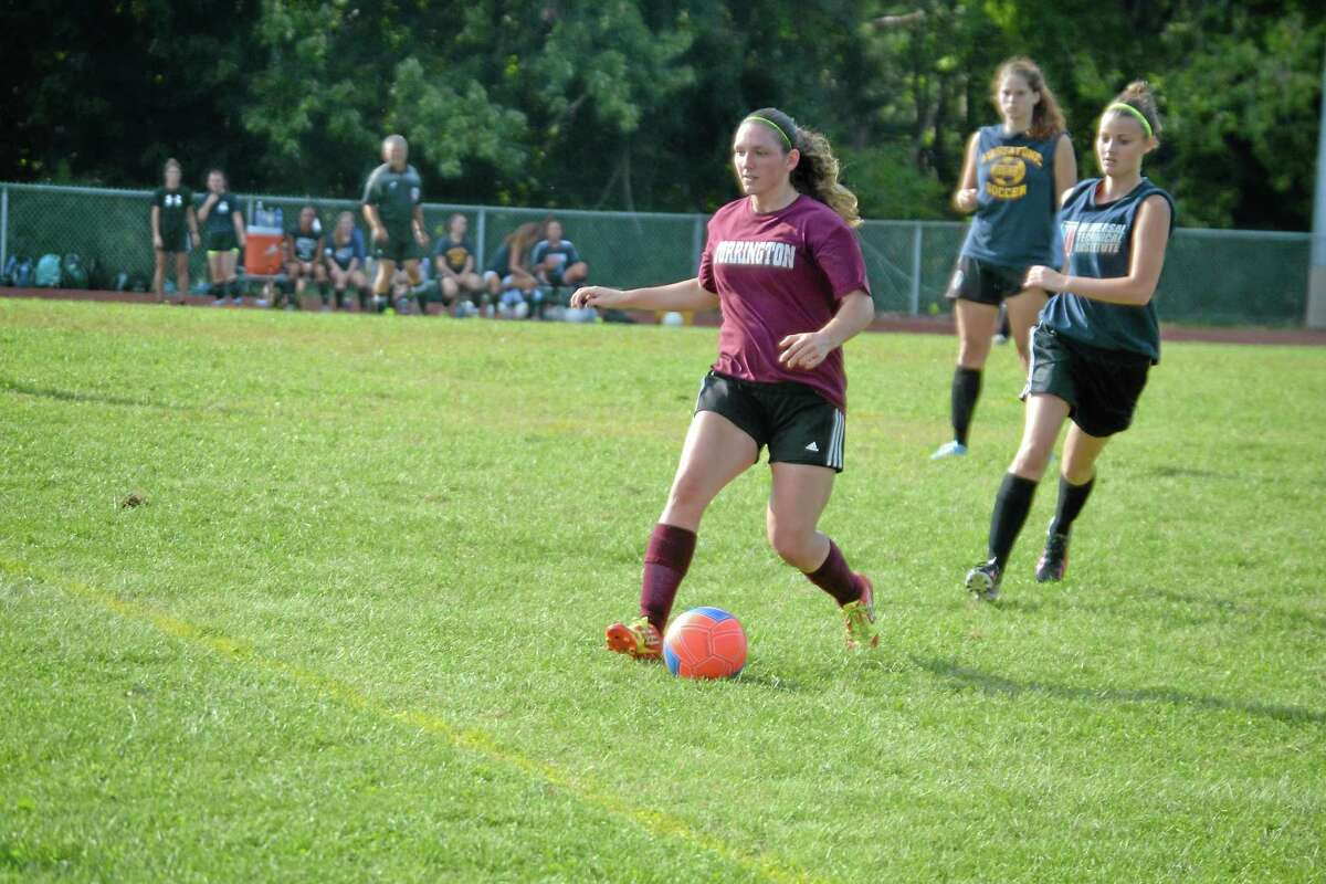 Courtney Dell'Agnese looks to pass during the Raiders scrimmage against Housatonic last week.