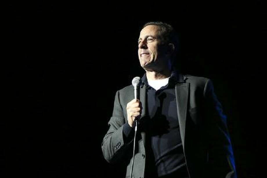 Comedian Jerry Seinfeld performs at the Stand Up for Heroes event at Madison Square Garden, Wednesday, Nov. 6, 2013, in New York. Photo: John Minchillo/Invision/AP / Invision