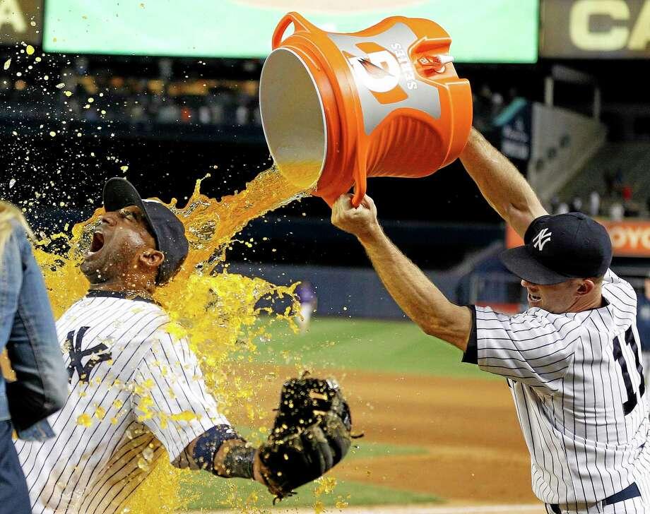 The Yankees' Brett Gardner (11) douses shortstop Eduardo Nunez after their 6-4 win over the Chicago White Sox at Yankee Stadium on Tuesday. Photo: John Minchillo — The Associated Press  / FR170537 AP
