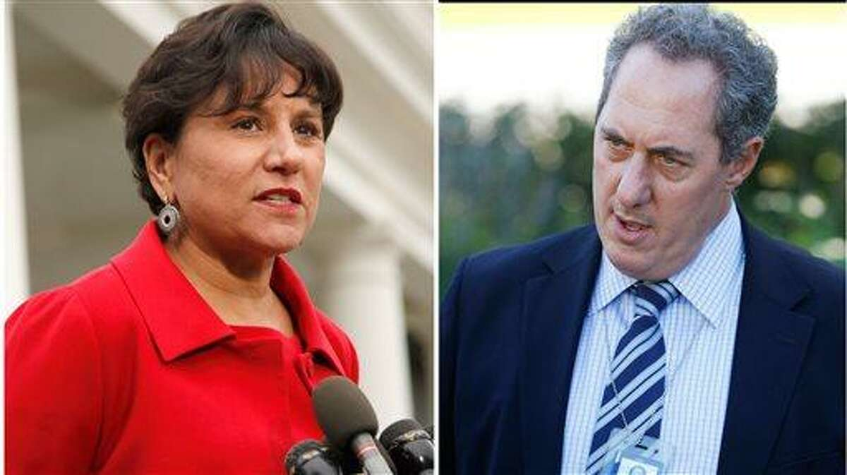 A White House official says President Barack Obama will name a longtime fundraiser to run the Commerce Department and a top economic adviser as the next U.S. Trade Representative. The Commerce nominee is expected to be Penny Pritzker, left, shown in a Oct. 4, 2010 file photo and The U.S. Trade Representative is expected to be Mike Froman seen in an Oct. 8, 2010 file photo. Obama will announce both nominations from the White House Thursday morning May 2, 2013 before departing for Mexico. (AP Photo/File)