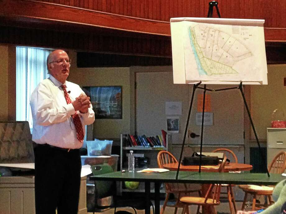 Gayla Cawley - Special to The Register Citizen Allan Borghesi presents a plan for an industrial park to be built along the New Hartford/Canton line during a Planning and Zoning Commission meeting in New Hartford Wednesday. Photo: Journal Register Co.