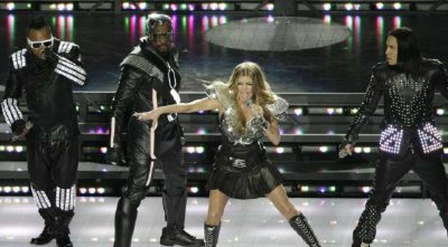 The Black Eyed Peas featuring Fergie (middle), will.i.am, Taboo and apl.de.ap performed during halftime of Super Bowl XLV in Arlington, Texas.