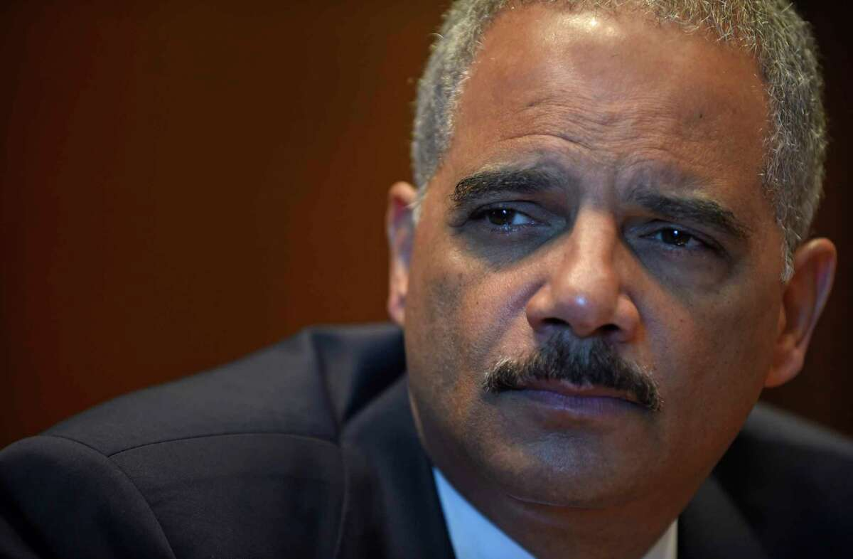 In this Sept. 16, 2014 file photo, Attorney General Eric Holder speaks during an interview with The Associated Press at the Justice Department in Washington. Holder is resigning after serving as head of the Justice Department for six years.
