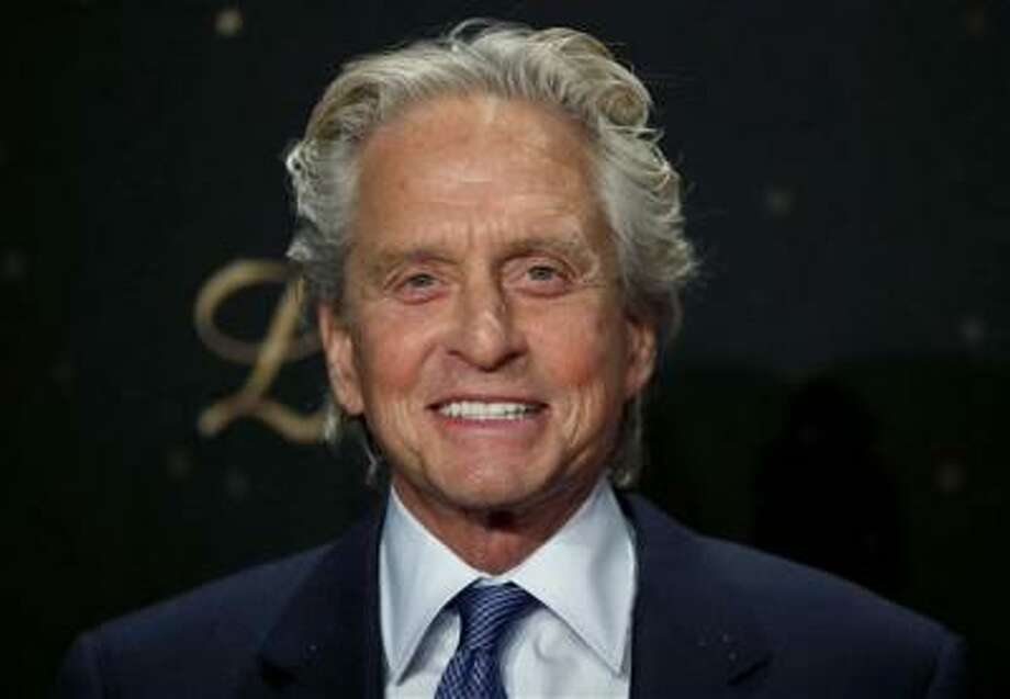 US actor Michael Douglas smiles as he arrives for the Germany premiere of the movie 'Behind The Candelabra' in Berlin, Germany, Monday, Sept. 2, 2013. (AP Photo/Michael Sohn) Photo: AP / AP
