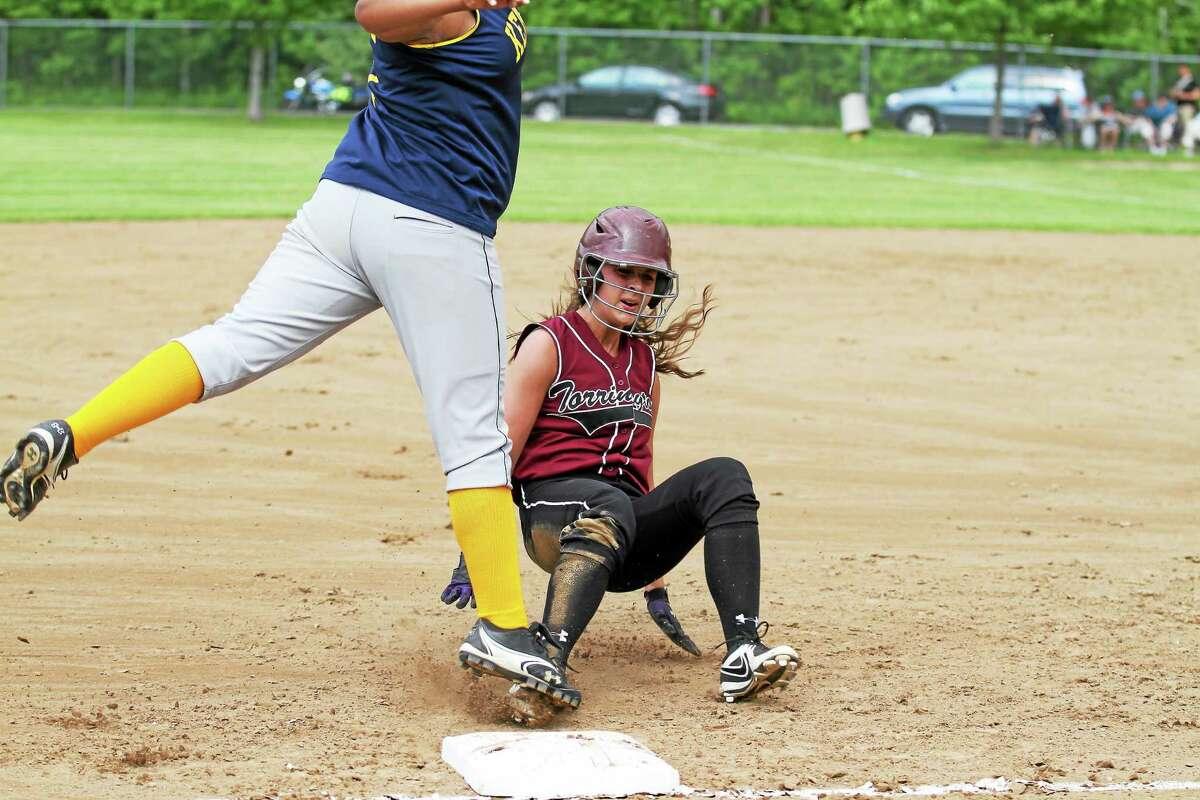 Torrington's Nikki Jamieson slides into third base. Jamiseon scored twice in the win.