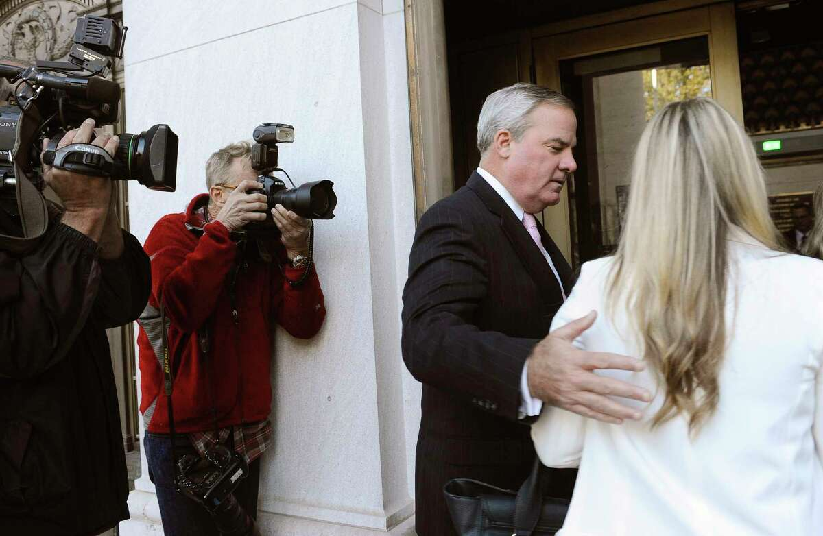 Former Connecticut Gov. John G. Rowland, second from right, arrives with his family at federal court on Sept. 18, 2014, in New Haven, Conn.