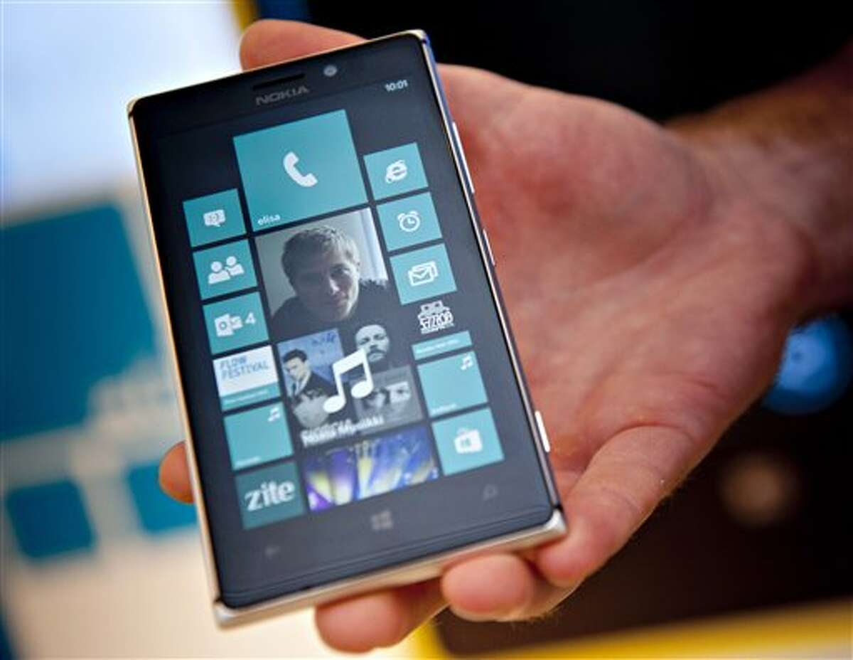 In this Aug. 15, 2013 photo, Nokia's Lumia 925 phone is shown at the flagship store of Finnish mobile phone manufacturer Nokia in Helsinki, Finland. Microsoft Corp. is buying Nokia Corp.'s devices and services business, and getting access to the company's patents, for a total of 5.44 billion euros ($7.2 billion) in an effort to expand its share of the smartphone market, the companies announced late Monday, Sept. 2, 2013. (AP Photo/Lehtikuva, Mikko Stig) FINLAND OUT