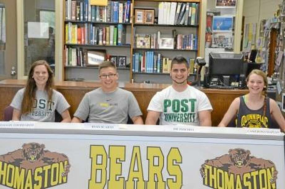 Pete Paguaga/Regsiter Citizen  From left to right: Maggie Eberhardt, Ryan Scarfo, Joe Foschini and Cameron Chaplen prepare to sign their letters of intent.