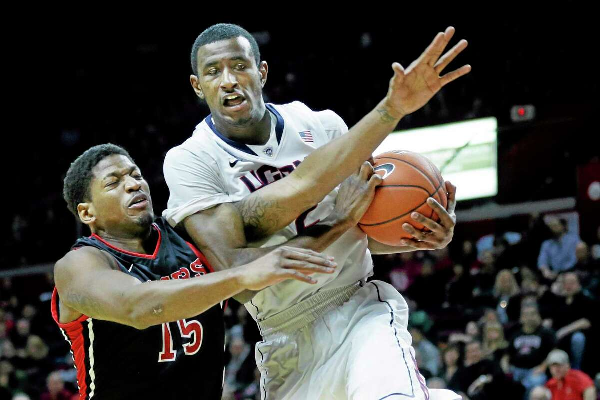 Rutgers guard Craig Brown (15) tries to make a steal on Connecticut forward DeAndre Daniels during the first half of an NCAA college basketball game Saturday, Jan. 25, 2014, in Piscataway, N.J. (AP Photo/Mel Evans)