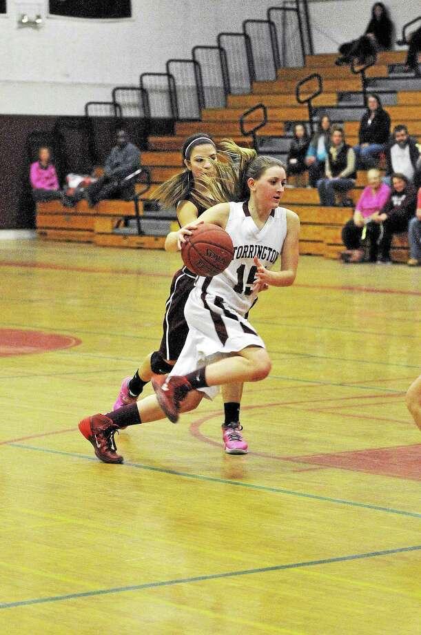 Torrington Caroline Teti drives to the basket past a Naugatuck defender. Photo: Laurie Gaboardi — Register Citizen