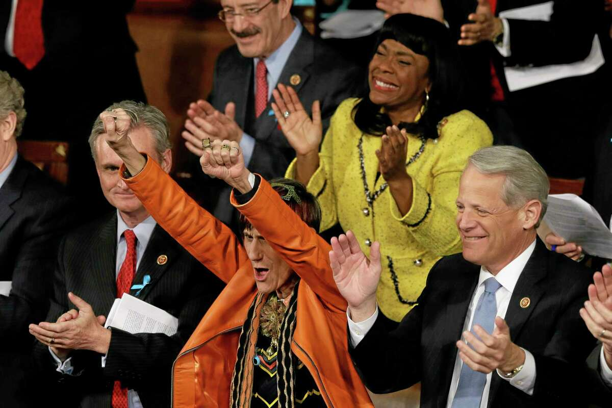 Rep. Rosa DeLauro, D-Conn., center, and Rep. Terri Sewell, D-Ala., cheer during President Barack Obama State of the Union address on Capitol Hill in Washington, Tuesday Jan. 28, 2014. (AP Photo/J. Scott Applewhite)