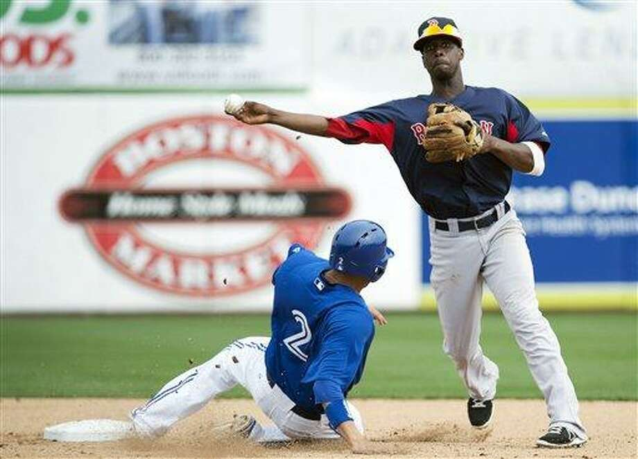 Boston Red Sox shortstop Pedro Ciriaco, right, forces out Toronto Blue Jays relief runner Ryan Goins, left, at second base during the fifth inning of a spring training baseball game in Dunedin, Fla., on Monday, Feb. 25, 2013. (AP Photo/The Canadian Press, Nathan Denette) Photo: ASSOCIATED PRESS / AP2013