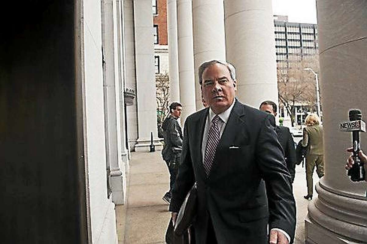 Rowland heads into courthouse.