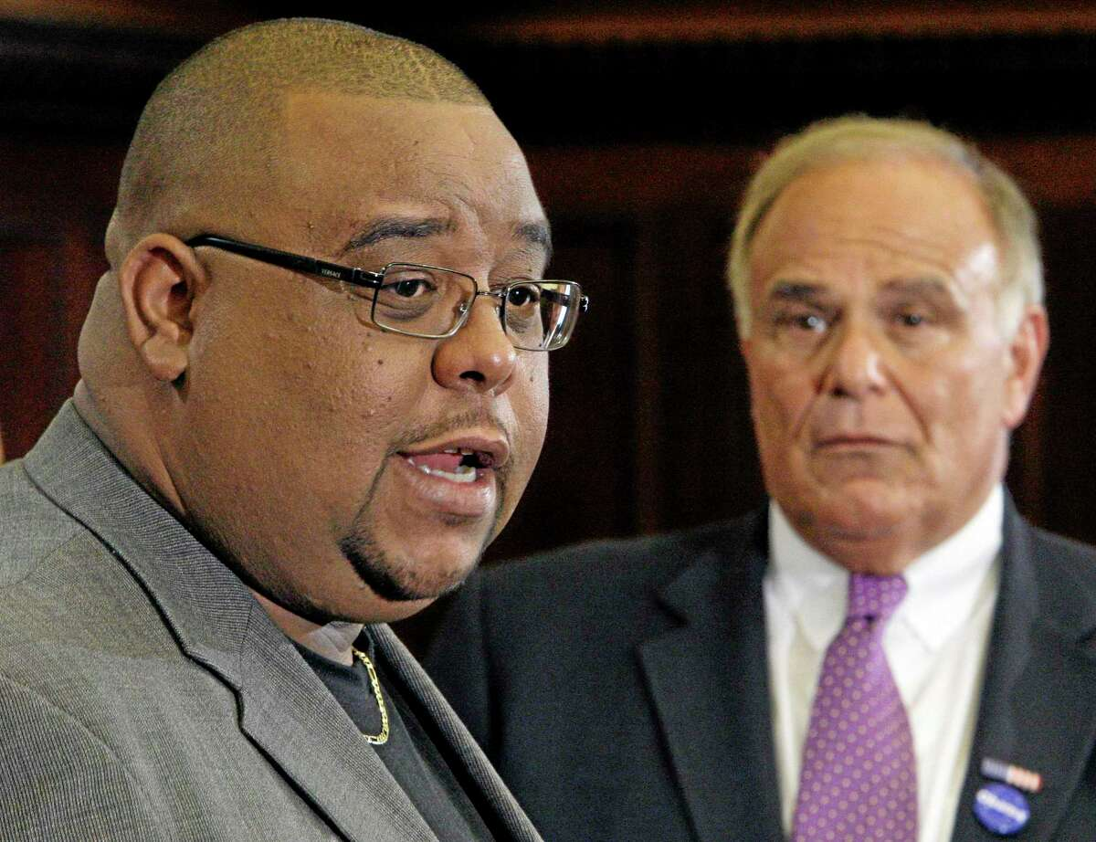 FILE - In this Sept. 10, 2008 file photo, Michael Thomas, chairman of the Mashantucket Pequot Tribal Nation in Connecticut, left, makes remarks as Gov. Ed Rendell listens during a news conference at City Hall in Philadelphia. Prosecutor Christopher Mattei said Monday, July 22, 2013 at the opening of a federal theft trial that Thomas improperly charged $80,000 to a tribe-issued credit card for a limousine to shuttle his mother to doctor's appointments. The charges in question were made on a tribe-issued American Express card between 2007 and 2009. Thomas has pleaded not guilty to one count of theft from an Indian tribal organization and two counts of theft concerning an Indian tribal government receiving federal funds. (AP Photo/Matt Rourke, File) (AP Photo/Matt Rourke)